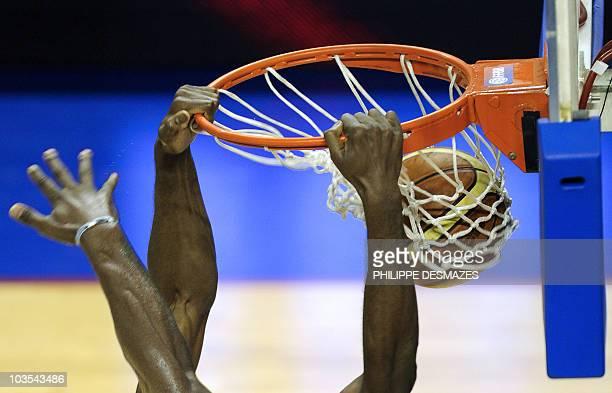 France's Alain Koffi scores a basket during the Villeurbanne's International tournament basketball match France vs Ivory Coast on August 22 2010 at...