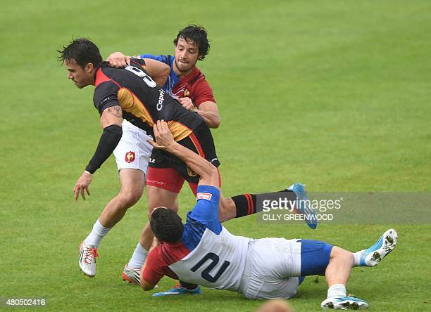 France's Alexandre Gracbling and Manoel Dall'Igna tackle Germany's Tim Biniak during the semifinal of the European Rugby Sevens Grand Prix Series...