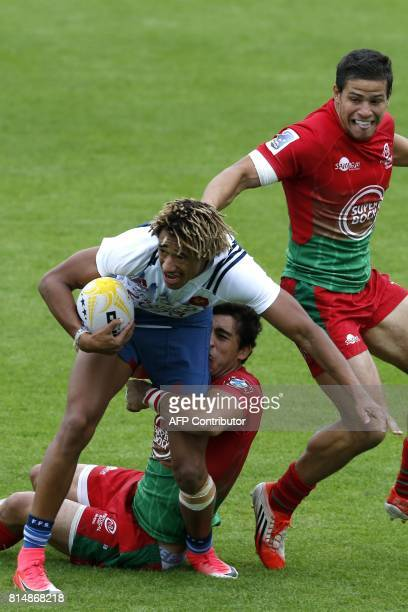 France's Alexandre Lagarde is tackled by Tomas Appleton during the rugby union sevens group stage game between France and Portugal on the first day...