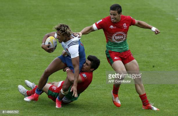 France's Alexandre Lagarde is tackled during the rugby union sevens group stage game between France and Portugal on the first day of the Exeter 7s...