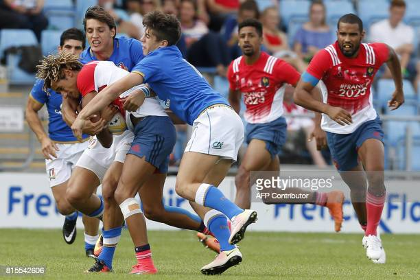 Frances Alexandre Lagarde is tackled during the rugby union sevens Challenge Trophy Final game between France and Italy on the second day of the...