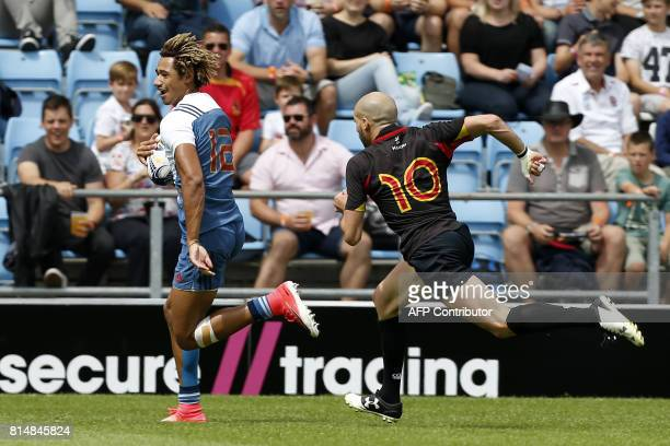 France's Alexandre Lagarde runs in a try during the rugby union sevens group stage game between France and Belgium on the first day of the Exeter 7s...