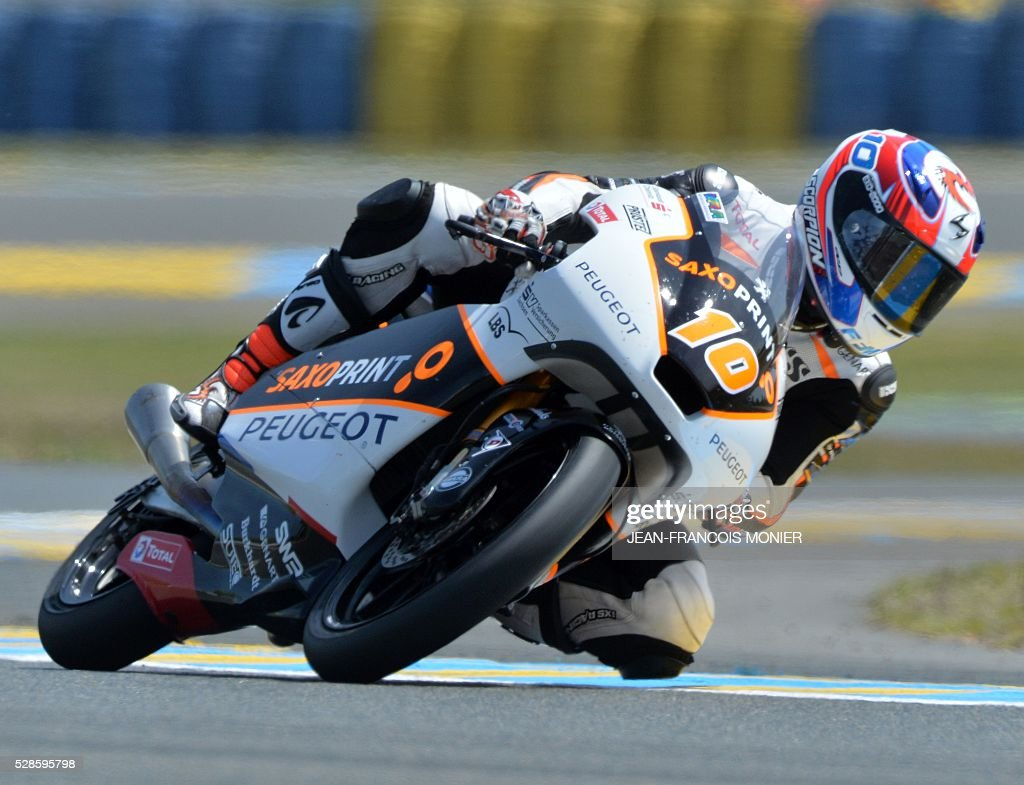 France's Alexis Masbou competes on his Peugeot Saxoprint N��5 during a moto3 free practice session, ahead of the French motorcycling Grand Prix, on May 6, 2016 in Le Mans. / AFP / JEAN