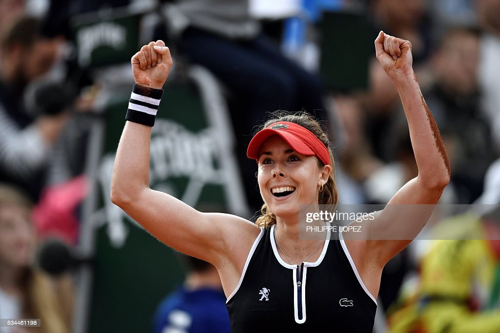 France's Alize Cornet celebrates after beating Germany's Tatjana Maria during their women's second round match at the Roland Garros 2016 French Tennis Open in Paris on May 26, 2016. / AFP / PHILIPPE