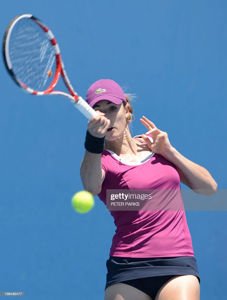 France's Alize Cornet plays a return to Marina Erakovic of New Zealand during their women's singles match on the first day of the Australian Open tennis tournament in Melbourne on January 14, 2013.