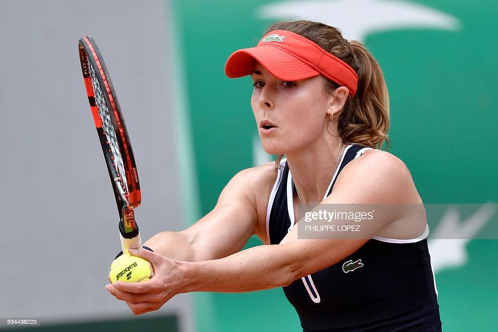 France's Alize Cornet prepares to serve against Germany's Tatjana Maria during their women's second round match at the Roland Garros 2016 French Tennis Open in Paris on May 26, 2016. / AFP / PHILIPPE