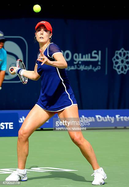 France's Alize Cornet returns the ball to Romania's Simona Halep during their match in the second day of the Dubai Duty Free Tennis Championships in...