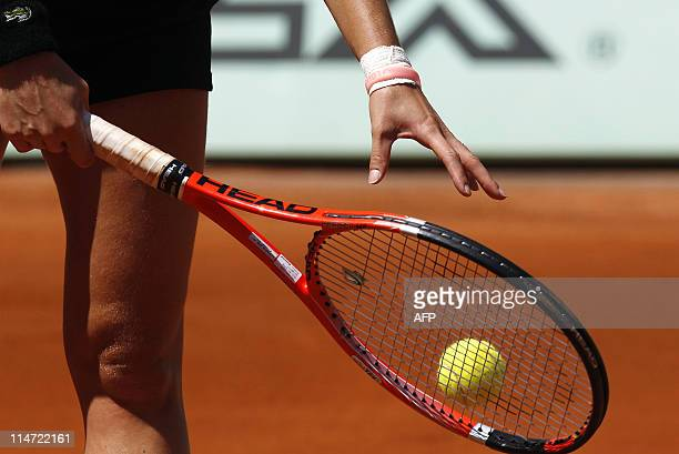 France's Alize Cornet serves to Spain's Nuria Llagostera Vives during a match break with during their Women's second round match in the French Open...
