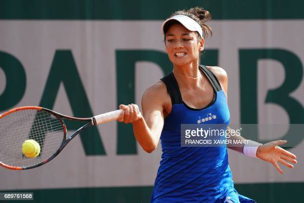 France's Alize Lim returns the ball to Poland's Magda Linette during their tennis match at the Roland Garros 2017 French Open on May 29 2017 in Paris...