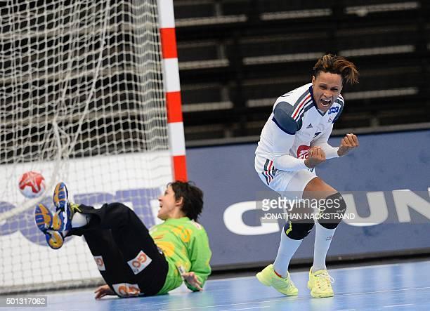 TOPSHOT France's Allison Pineau celebrates after scoring a goal past Spain's goalkeeper Darly Zoqbi De Paula during the 2015 Women's Handball World...