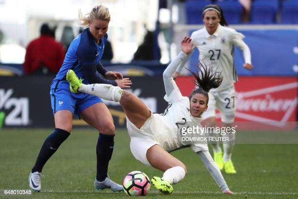 France's Amandine Henry and Germany's Hasret Kayikci vie for the ball as the France and Germany women's national teams play in the SheBelieves Cup in...