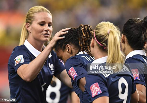 France's Amandine Henry congratulates Elodie Thomis after she scored against South Korea during a 2015 FIFA Women's World Cup round of 16 match at...