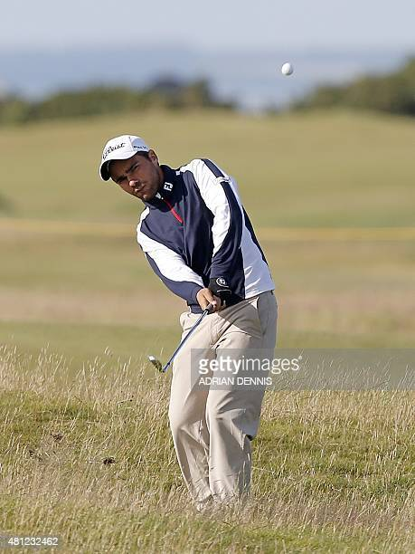 France's amateur golfer Romain Langasque chips during the completion of his second round 72 on day three of the 2015 British Open Golf Championship...