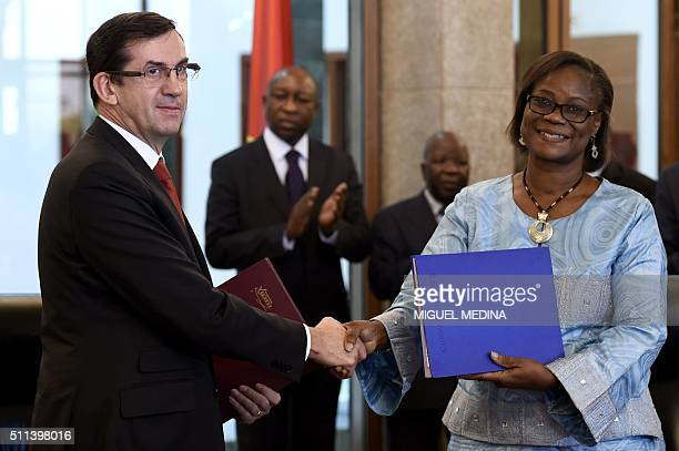 France's Ambassador to Burkina Faso Gilles Thibault shakes hands with Burkina Faso Minister of Economy and Development Rosine SoriCoulibaly after...