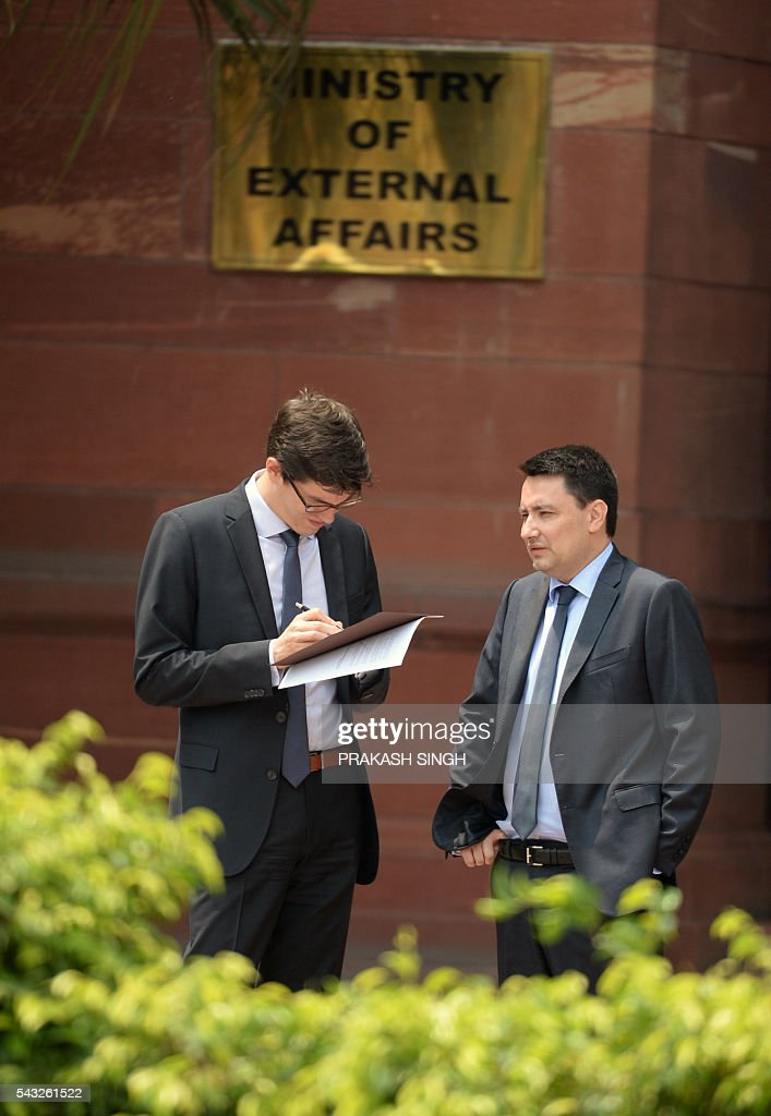 France's ambassador to India Alexandre Ziegler talks with a colleague after handing over membership papers for the Missile Technology Control Regime (MTCR) partnership to Indian Foreign Secretary Subrahmanyam Jaishankar at the Indian Ministry of External Affairs in New Delhi on June 27, 2016. India on June 27 joined the Missile Technology Control Regime (MTCR) as a full member. / AFP / PRAKASH