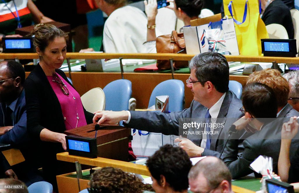 France's Ambassador to the UN Francois Delattre deposits his vote during election of five non-permanent members of the Security Council at the General Assembly Hall at the United Nations in New York on June 28 2016. Three European countries and two Asian nations are battling for seats on the UN Security Council in elections that are drawing attention to the refugee crisis and human rights. / AFP / KENA