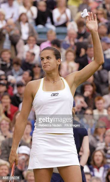 France's Amelie Mauresmo celebrates her win against USA's Jamea Jackson during The All England Lawn Tennis Championship at Wimbledon