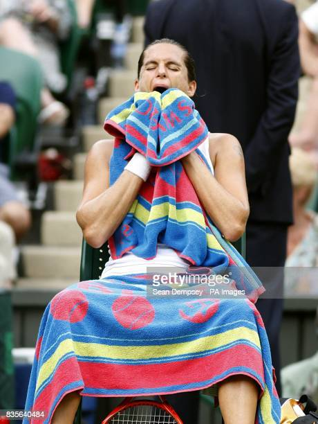 France's Amelie Mauresmo during a break in play in her match against Russia's Dinara Safina during the Wimbledon Championships 2009 at the All...