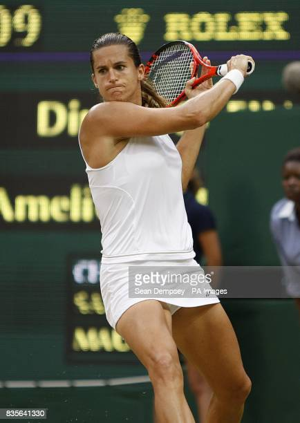 France's Amelie Mauresmo in action against Russia's Dinara Safina during the Wimbledon Championships 2009 at the All England Tennis Club