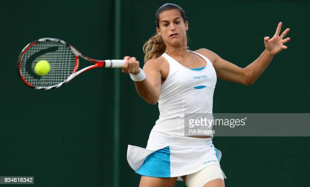 France's Amelie Mauresmo in action against Spain's Virginia Ruano Pascual during The Wimbledon Championships at The All England Lawn Tennis Club...