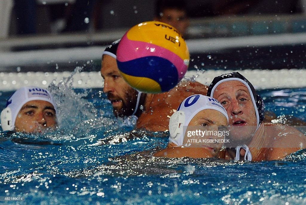 France's Amoud Jablonski and his teammate Thibaut Simon vie with Hungary's Denes Varga and Miklos GorNagy during the Water Polo European...