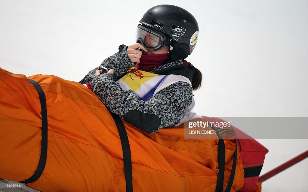 France's Anais Caradeux reacts as she is transported in a rescue sledge after she crashed during the Women's Ski Halfpipe Finals of FIS Freestyle and Snowboarding World Ski Championships in Kreischberg, Austria on January 22, 2015. AFP PHOTO / LISI NIESNER