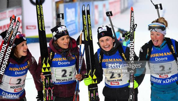 France's Anais Chevalier Celia Aymonier Justine Braisaz and Marie Dorin Habert react in the finish area after winning the third palce in the 2017 IBU...