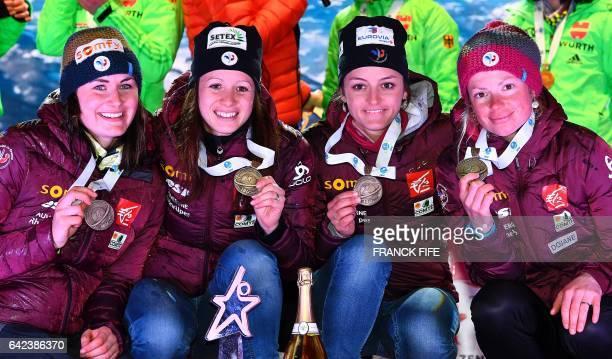 France's Anais Chevalier Celia Aymonier Justine Braisaz and Marie Dorin Habert celebrate on the podium with their medals of the 2017 IBU World...