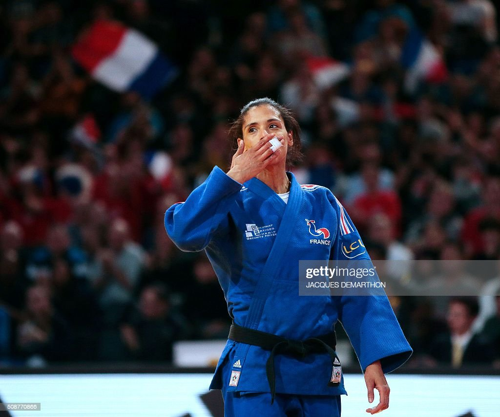 France's Annabelle Euranie celebrates beating South Korea's Kim Mi-Ri in the women's under 52 kg bronze medal fight of the Paris Grand Slam Judo tournament on February 6, 2016 in Paris. / AFP / JACQUES DEMARTHON