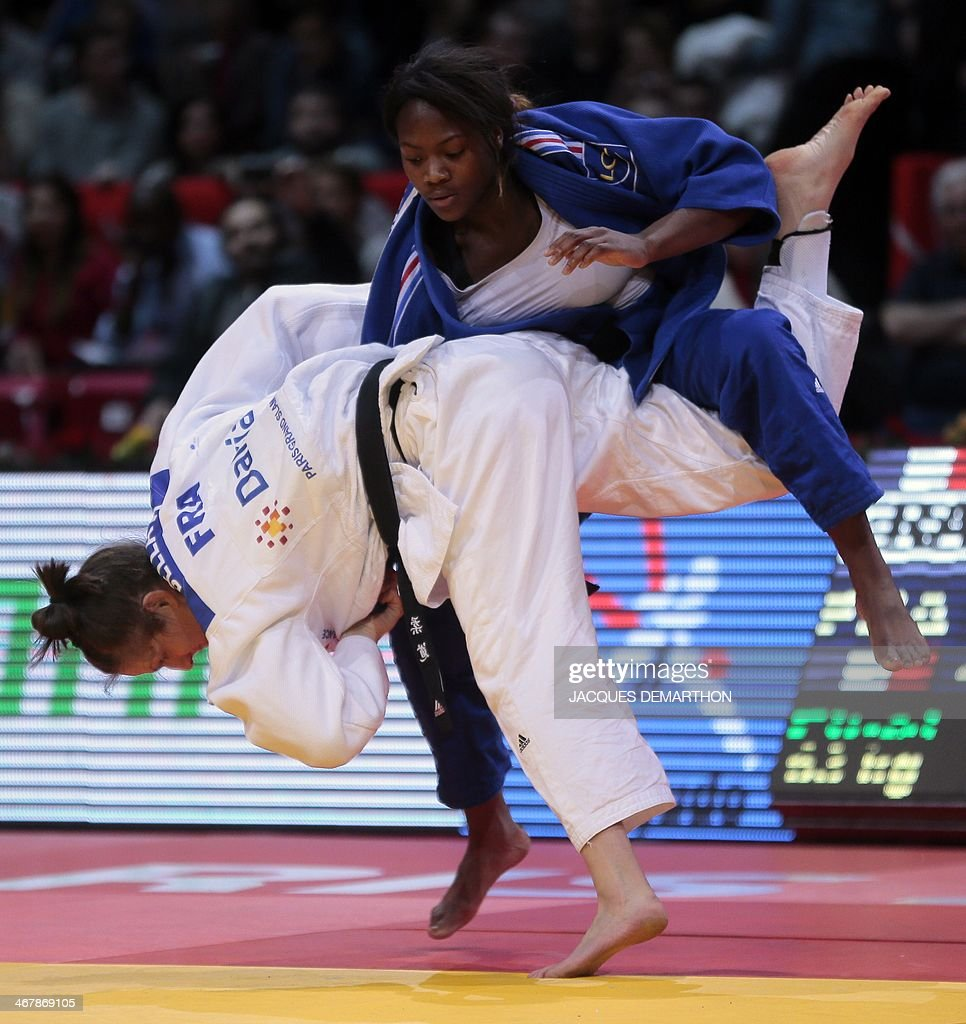 France's AnneLaure Bellard competes against France's Clarisse Agbegnenou during the under 63kg finals at the2014 Paris Judo Grand Slam tournament on...
