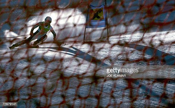 France's AnneSophie Barthet is seen through safety nets as she takes women's downhill practice during alpine FIS World Cup in AltenmarktZauchensee 11...