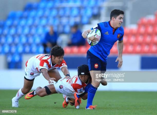 France's Anthony Belleau is tackled against Japan