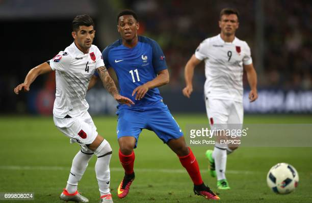 France's Anthony Martial and Albania's Elseid Hysaj battle for the ball