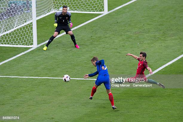 France's Antoine Griezmann shoots wide under pressure from Portugal's Cedric Soares during the UEFA Euro 2016 Final match between Portugal and France...