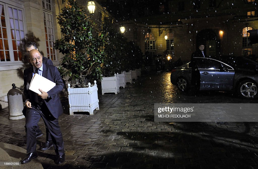 France's armies chief of staff, French Defence Minister Jean-Yves Le Drian arrives for a meeting hosted by French Prime Minister to inform leaders of French political parties on France's military intervention in Mali on January 14, 2013 at the Hotel Matignon in Paris. France launched its operation against Mali-based Islamists on a unilateral basis on January 11, but has since been offered logistical support by several NATO allies, including Belgium, Britain, Denmark, Germany and the United States.