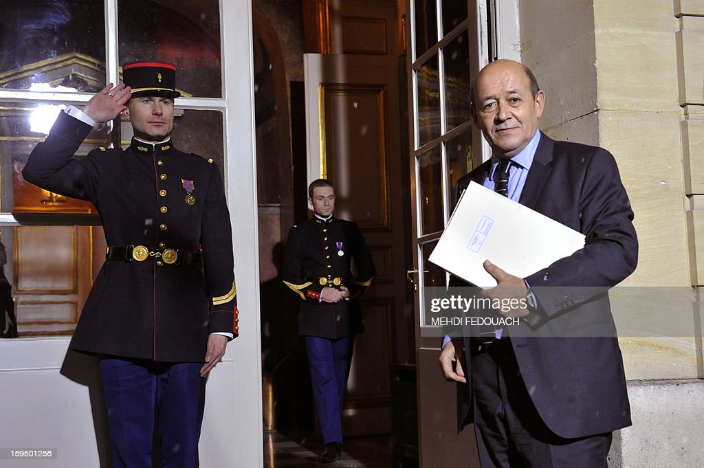 France's armies chief of staff, French Defence Minister Jean-Yves Le Drian arrives for a meeting hosted by French Prime Minister to inform leaders of French political parties on France's military intervention in Mali on January 14, 2013 at the Hotel Matignon in Paris. France launched its operation against Mali-based Islamists on a unilateral basis on January 11, but has since been offered logistical support by several NATO allies, including Belgium, Britain, Denmark, Germany and the United States. AFP PHOTO MEHDI FEDOUACH