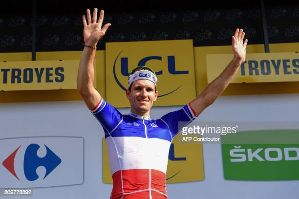 France's Arnaud Demare arrives on the podium to celebrate his green jersey of best sprinter at the end of the 216 km sixth stage of the 104th edition...