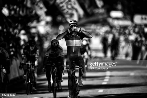 France's Arnaud Demare celebrates as he crosses the finish line ahead of Slovakia's Peter Sagan at the end of the 2075 km fourth stage of the 104th...