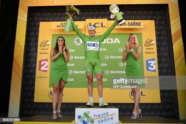 France's Arnaud Demare celebrates his green jersey of best sprinter on the podium at the end of the 1605 km fifth stage of the 104th edition of the...