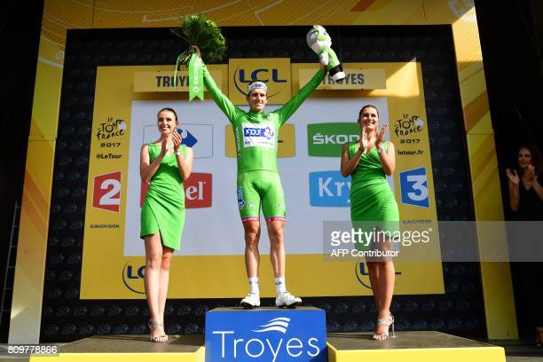 France's Arnaud Demare celebrates his green jersey of best sprinter on the podium at the end of the 216 km sixth stage of the 104th edition of the...