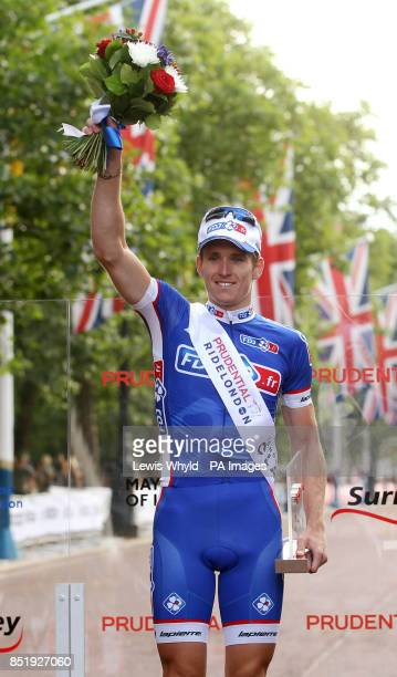 France's Arnaud Demare celebrates winning the Prudential LondonSurrey 100 bike race during day two of the Ridelondon Grand Prix London