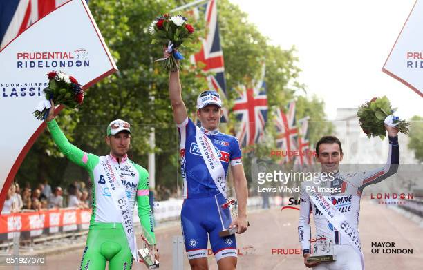 France's Arnaud Demare celebrates winning the Prudential LondonSurrey 100 bike race with Italy's Sacha Modolo in second and France's Yannick Martinez...