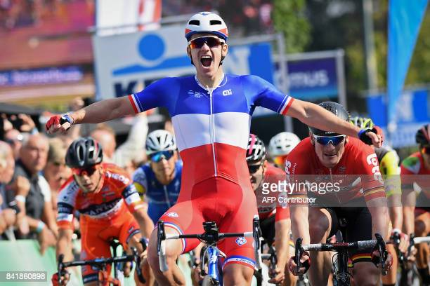 France's Arnaud Demare of FDJ celebrates as he crosses the finishline to win the 5th edition of the 'Brussels Cycling Classic' cycling race3 kms from...