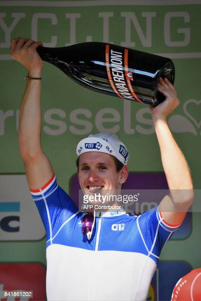 France's Arnaud Demare of FDJ celebrates on the podium after winning the 5th edition of the 'Brussels Cycling Classic' cycling race3 kms from and to...