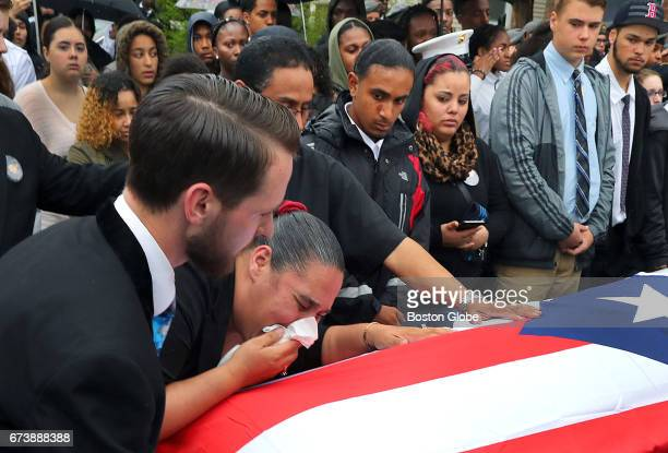 Frances Arriaga Caban the mother of Brockton High School student Isaias Caban who was killed last week in a car crash in Brockton cries on the casket...