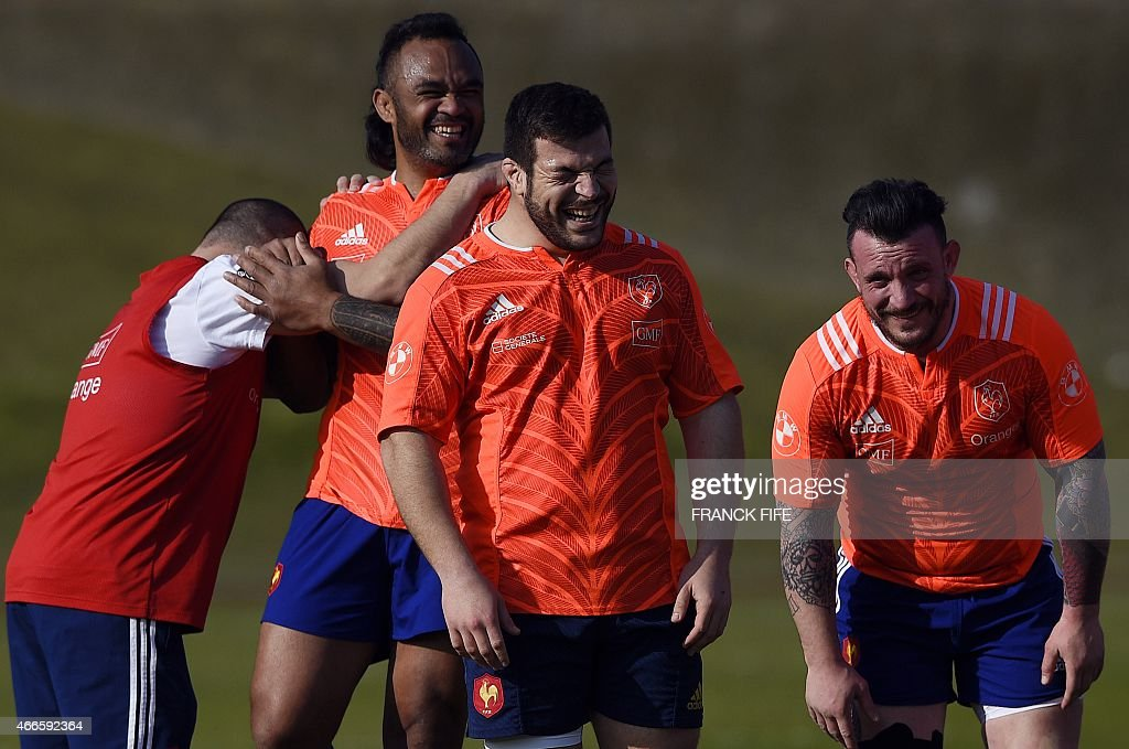 France's assistant coach Yannick Bru, France's lock Jocelino Suta, France's tighthead prop Rabah Slimani and France's prop Thomas Domingo joke during a training session in Marcoussis, south of Paris, on March 17, 2015 ahead of the Six Nations rugby union match between France and England.