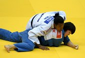 France's Audrey Tcheumeo competes with North Korea's Kyong Sol during the under 78 kg semifinal at the IJF World Judo Championship in Chelyabinsk on...