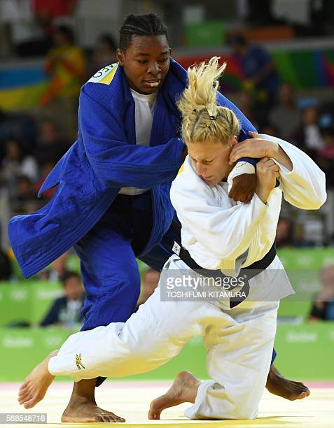 France's Audrey Tcheumeo competes with US Kayla Harrison during their women's 78kg judo contest gold medal match of the Rio 2016 Olympic Games in Rio...