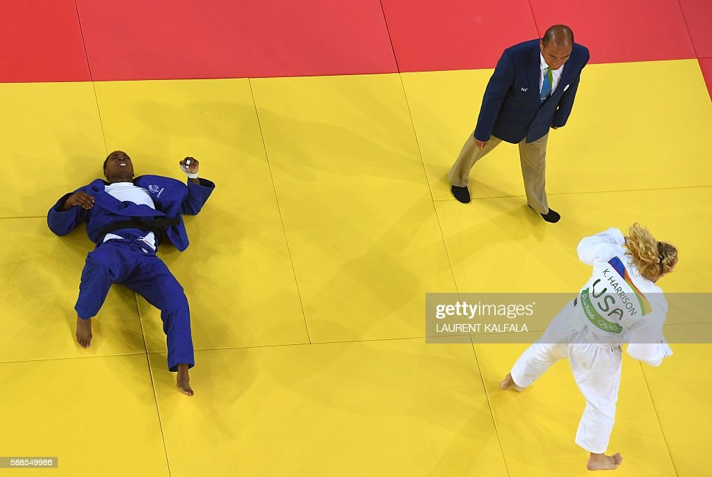 France's Audrey Tcheumeo (blue) reacts after losing to US Kayla Harrison during their women's -78kg judo contest gold medal match of the Rio 2016 Olympic Games in Rio de Janeiro on August 11, 2016. / AFP / Laurent KALFALA