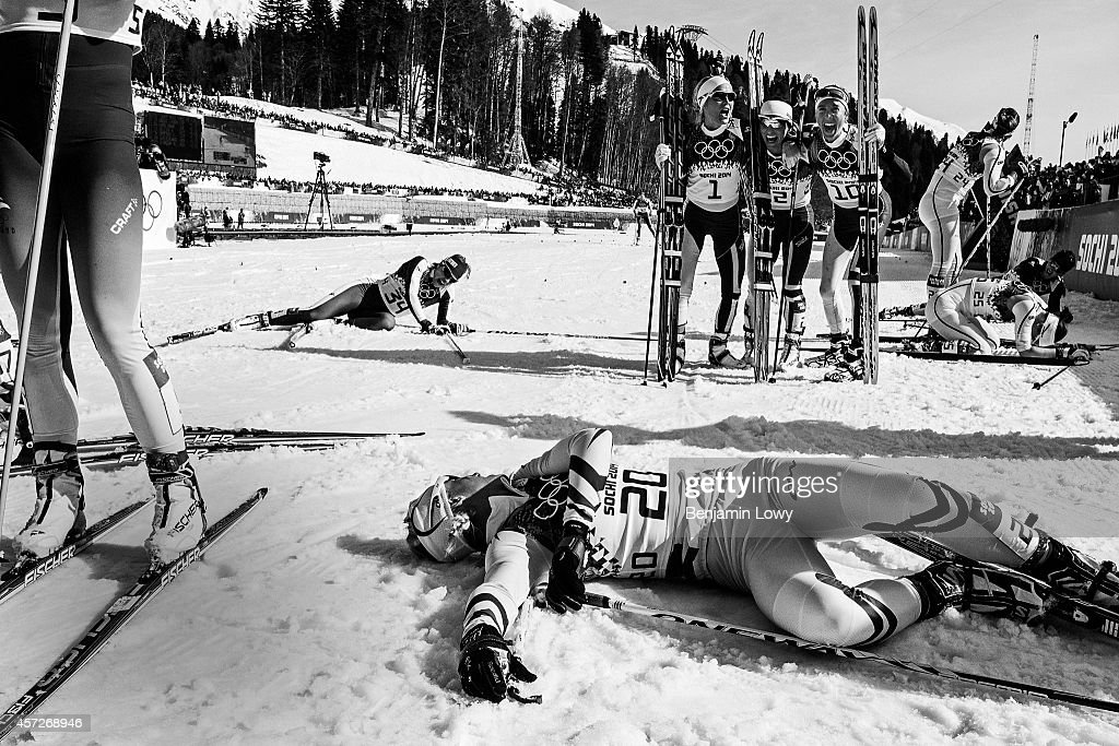 France's Aurore Jean rests at the finish line as silver medalist Norway's Therese Johaug gold medalist Norway's Marit Bjoergen and bronze medalist...